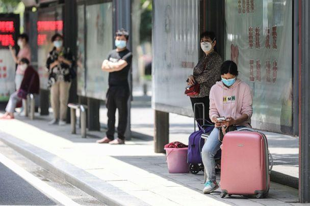 PHOTO: People wait at a bus station in Wuhan in China's central Hubei province on May 11, 2020. (AFP via Getty Images)