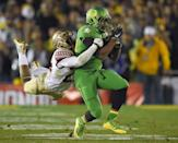 Florida State defensive back P.J. Williams, left, tackles Oregon running back Kani Benoit during the second half of the Rose Bowl NCAA college football playoff semifinal, Thursday, Jan. 1, 2015 in Pasadena, Calif. (AP Photo/Mark J. Terrill)