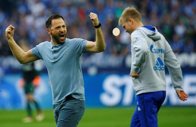 Soccer Football - Bundesliga - Schalke 04 vs Borussia Dortmund - Veltins-Arena, Gelsenkirchen, Germany - April 15, 2018 Schalke coach Domenico Tedesco celebrates at the end of the match REUTERS/Leon Kuegeler DFL RULES TO LIMIT THE ONLINE USAGE DURING MATCH TIME TO 15 PICTURES PER GAME. IMAGE SEQUENCES TO SIMULATE VIDEO IS NOT ALLOWED AT ANY TIME. FOR FURTHER QUERIES PLEASE CONTACT DFL DIRECTLY AT + 49 69 650050
