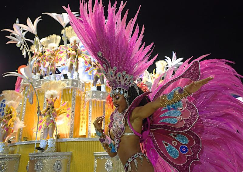 TOPSHOT - Members of the Paraiso do Tuiuti samba school perform during the second night of Rio's Carnival parade at the Sambadrome in Rio de Janeiro, Brazil early on March 4, 2019. - (Photo by CARL DE SOUZA / AFP) (Photo credit should read CARL DE SOUZA/AFP via Getty Images)