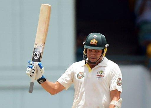 Australian cricketer Ryan Harris rises his bat after completing his half century (50 runs) during the fourth day of the first-of-three Test matches between Australia and West Indies at the Kensington Oval stadium in Bridgetown