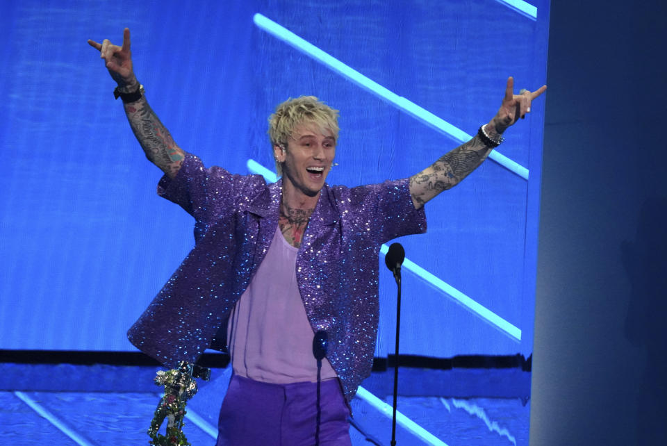 """Machine Gun Kelly accepts the award for best alternative song for """"My Ex's Best Friend"""" at the MTV Video Music Awards at Barclays Center on Sunday, Sept. 12, 2021, in New York. (Photo by Charles Sykes/Invision/AP)"""