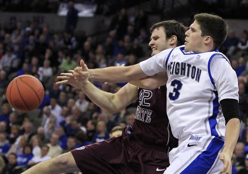 Missouri State's Christian Kirk, left, and Creighton's Doug McDermott reach for a rebound in the second half of an NCAA college basketball game in Omaha, Neb., Wednesday, Jan. 30, 2013. Creighton won 91-77. (AP Photo/Nati Harnik)