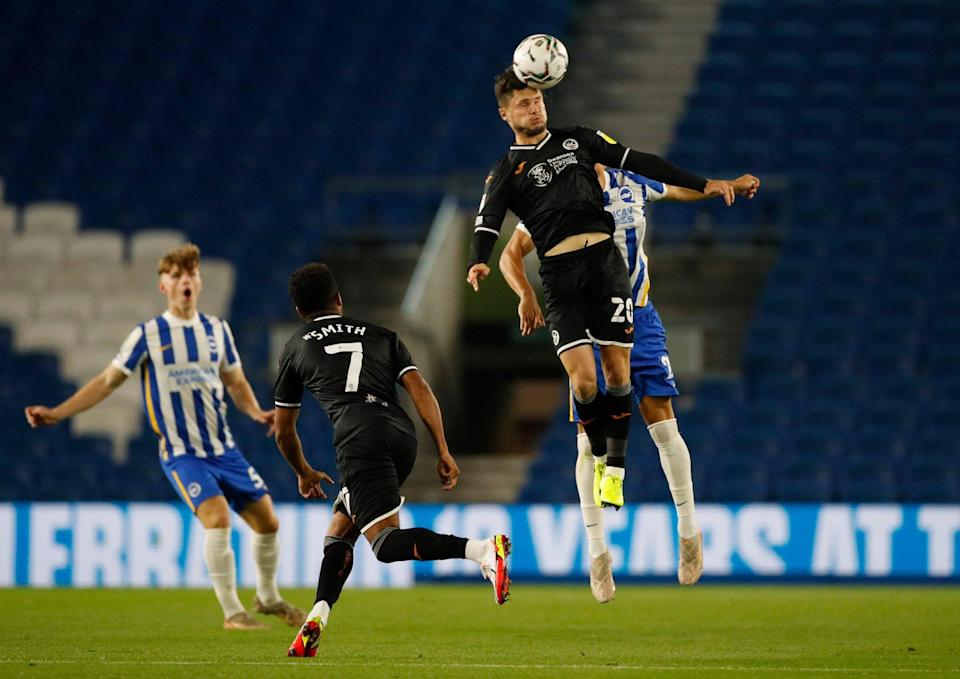 Swansea City's Liam Cullen in action with Brighton & Hove Albion's Hayden Roberts - Action Images via Reuters/Andrew Boyers