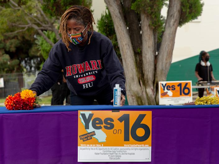 Proposition 16 supporters rally during early voting in California