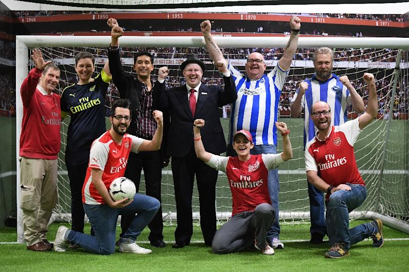 Players from the gay supporters' teams of Arsenal and Brighton pose for a photo during a penalty shoot-out competition at the Arsenal Hub in north London on October 1, 2017, ahead of the Premier League game between the two teams