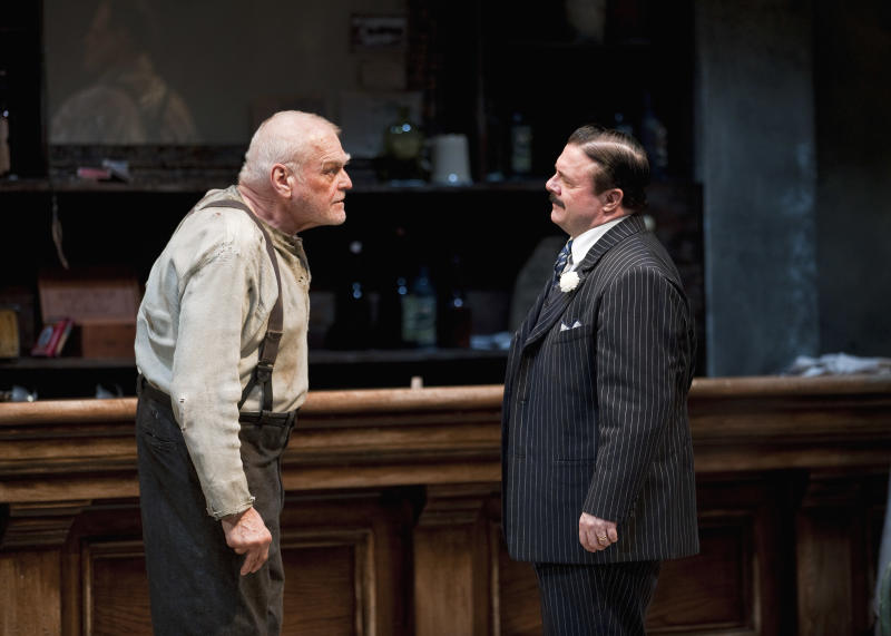 "In this April 20, 2012, production photo provided by the Goodman Theatre in Chicago, actors Brian Dennehy, left, portraying one-time syndicalist-anarchist Larry Slade and Nathan Lane as Theodore ""Hickey"" Hickman perform in a scene in Eugene O'Neill's ""The Iceman Cometh"" directed by Robert Falls. The epic drama runs through June 17. (AP Photo/Courtesy of The Goodman Theatre, Liz  Lauren)"