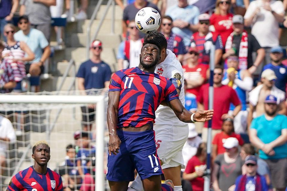 USMNT forward Daryl Dike (11) heads the ball during Sunday's win over Canada.
