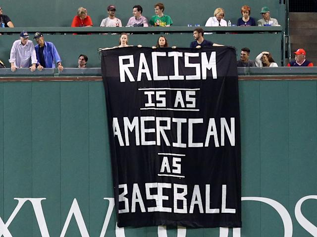 The individuals were escorted out of the stadium after revealing the banner: Getty
