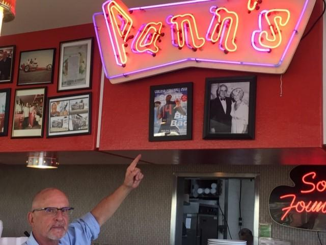 Jim Poulos, the owner of Pann's Restaurant in Los Angeles, points at the August 2018 Sports Illustrated regional cover picturing a neighborhood kid, LA-born Arizona quarterback Khalil Tate. | Ross Dellenger/Sports Illustrated