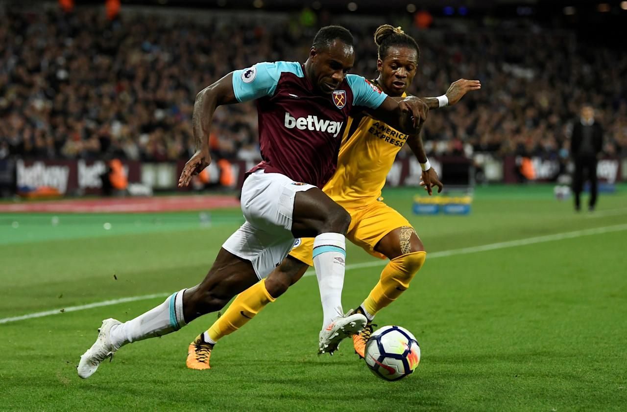"""Soccer Football - Premier League - West Ham United vs Brighton & Hove Albion - London Stadium, London, Britain - October 20, 2017   West Ham United's Michail Antonio in action with Brighton's Gaetan Bong        Action Images via Reuters/Tony O'Brien    EDITORIAL USE ONLY. No use with unauthorized audio, video, data, fixture lists, club/league logos or """"live"""" services. Online in-match use limited to 75 images, no video emulation. No use in betting, games or single club/league/player publications. Please contact your account representative for further details.     TPX IMAGES OF THE DAY"""