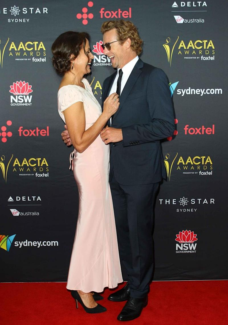 Simon Baker and his wife Rebecca Rigg looked loved-up on the red carpet. Source: Getty