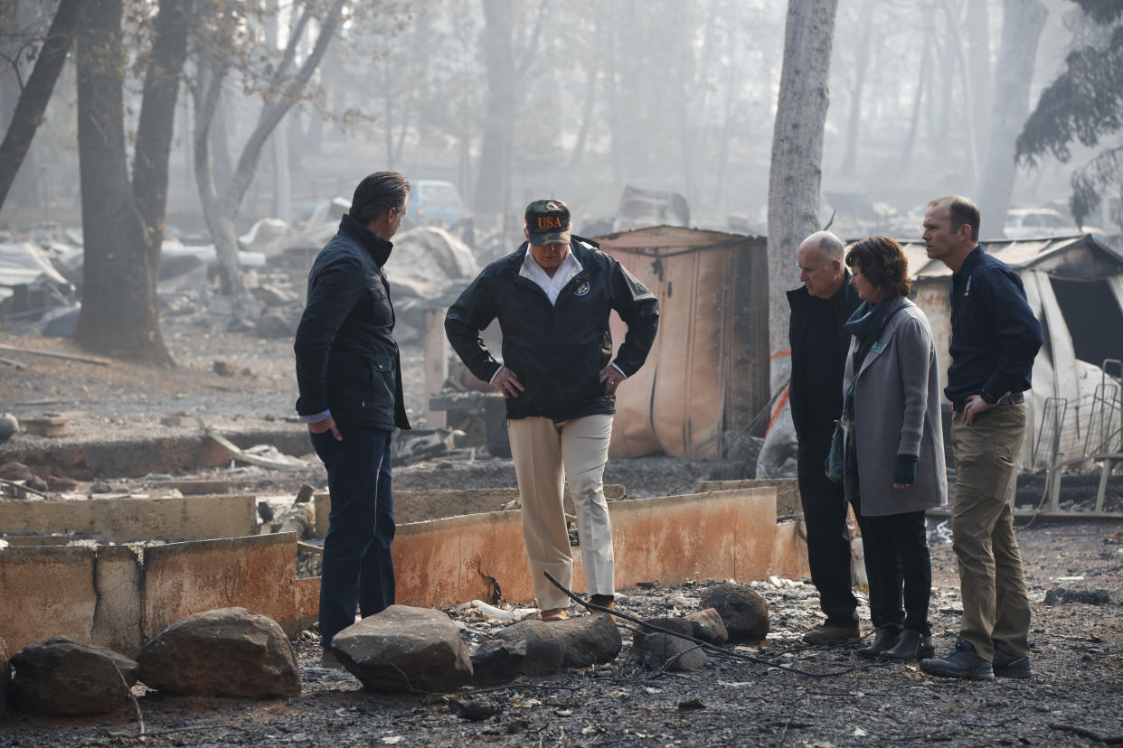 President Trump visits a neighborhood hit by wildfires on Nov. 17, 2018, in Paradise, Calif. (Photo: Evan Vucci/AP)