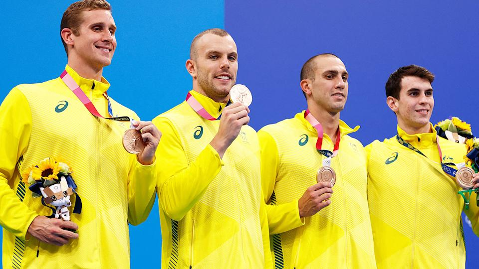 Australia's bronze medal winning 4x200m freestyle relay team came withing three hundredth of a second of being disqualified under a unique rule. (Photo by ODD ANDERSEN/AFP via Getty Images)