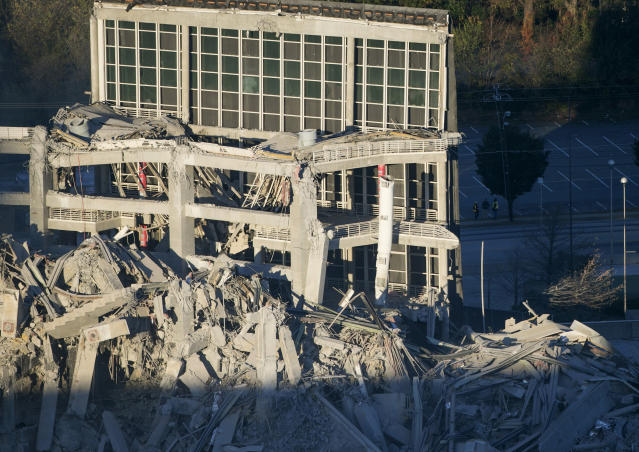 <p>Remains pile up after the Georgia Dome is destroyed in a scheduled implosion Monday, Nov. 20, 2017, in Atlanta. The dome was not only the former home of the Atlanta Falcons but also the site of two Super Bowls, 1996 Olympics Games events and NCAA basketball tournaments among other major events. (Bob Andres/Atlanta Journal-Constitution via AP) </p>