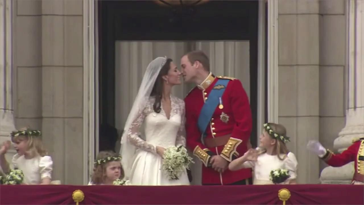 See the royal couple showing public displays of affection.