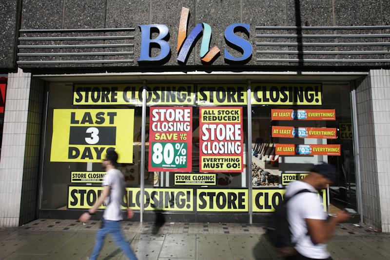 Pedestrians walk past the BHS store in Wood Green, London, as the last remaining stores are expected to close this weekend, with the doomed retailer set to disappear from the high street entirely by Sunday.