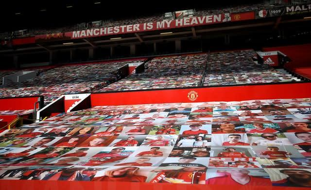 Fan pictures on banners covering the seats in the stands at Old Trafford (Martin Rickett/NMC Pool/PA)