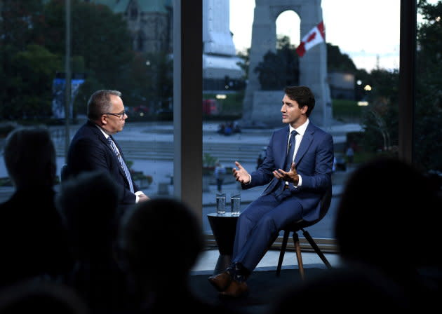 Prime Minister Justin Trudeau participates in an armchair discussion with Maclean's Paul Wells in Ottawa on Sept. 17, 2018.