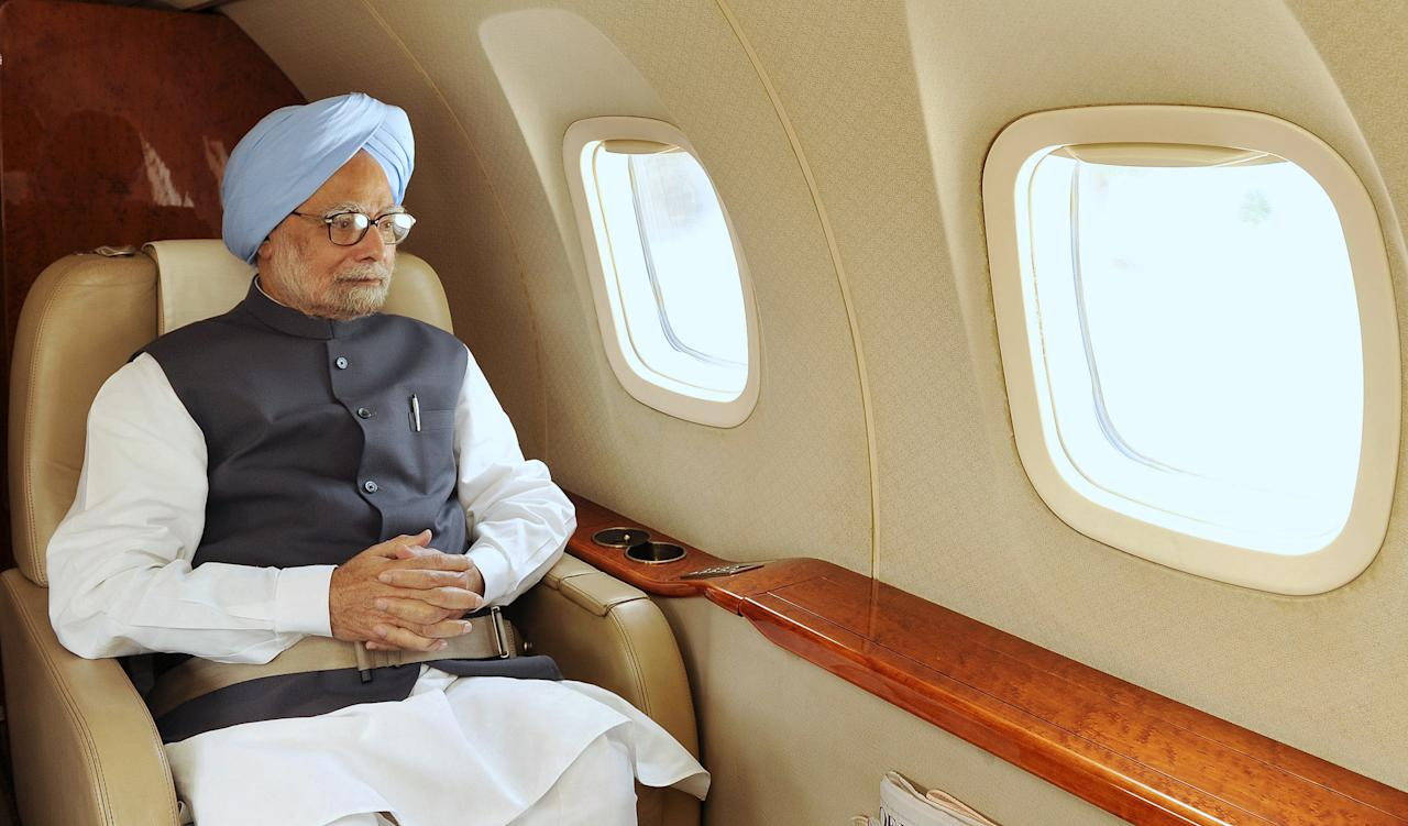 """In this photograph received from the Press Information Bureau (PIB) on June 19, 2013 Indian Prime Minister Manmohan Singh is pictured in flight making an aerial survey of disaster affected areas of Uttarakhand.  Military helicopters dropped emergency supplies June 19 to thousands of people stranded by flash floods that tore through towns and temples in northern India and neighbouring Nepal, killing more than 160, officials said.   AFP PHOTO/PIB/AMIT AMRIT      ----EDITORS NOTE---- RESTRICTED TO EDITORIAL USE - MANDATORY CREDIT - """"AFP PHOTO/PIB/AMIT AMRIT"""" - NO MARKETING NO ADVERTISING CAMPAIGNS - DISTRIBUTED AS A SERVICE TO CLIENTS -----"""