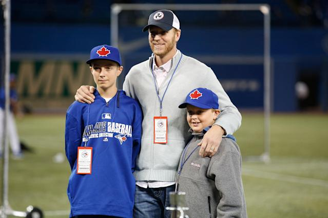 Braden Halladay, left, with his late father Roy Halladay, is now eligible for the MLB Draft. (Carlos Osorio/Toronto Star via Getty Images)