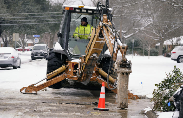 Nathan Bercy, with the City of Richardson water department, begins to open access to make repairs to a water main break due to extreme cold Wednesday, Feb. 17, 2021, in Richardson, Texas. Water service providers in Tennessee, Oklahoma, Texas and other states hit hard by frigid winter storms and mounting power outages are asking residents to restrict usage as reports of water main breaks, low pressure and busted pipes emerge. (AP Photo/LM Otero)