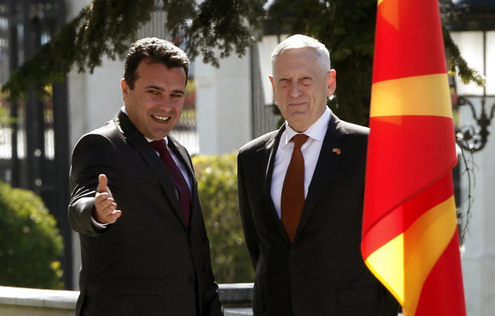 U.S. Defense Secretary James Mattis, right, is welcomed by Macedonian Prime Minister Zoran Zaev, left, upon his arrival at the government building in Skopje, Macedonia, Monday, Sept. 17, 2018. Mattis arrived in Macedonia Monday, condemning Russian efforts to use its money and influence to build opposition to an upcoming vote that could pave the way for the country to join NATO, a move Moscow opposes. (AP Photo/Boris Grdanoski)