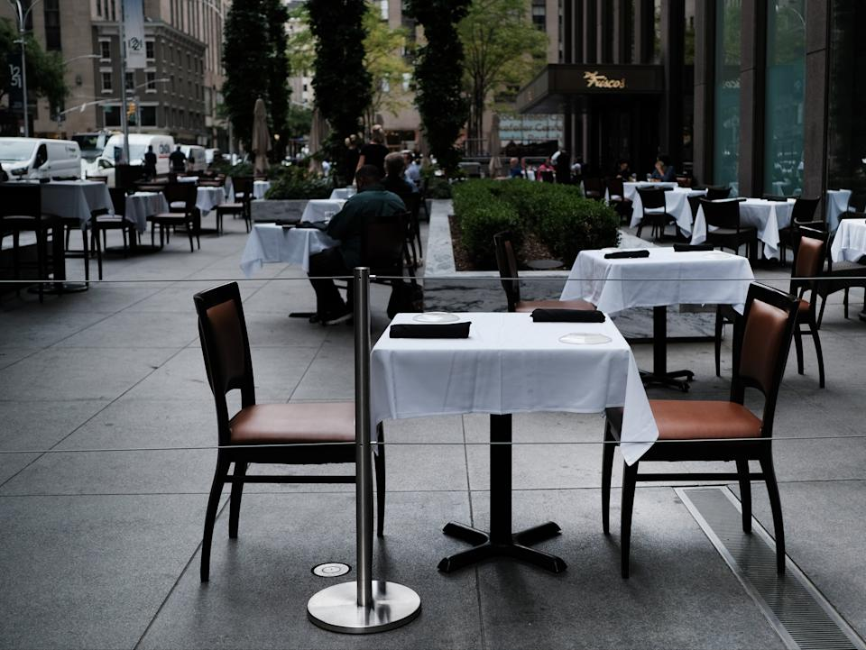 <p>New York City restaurants are currently permitted to serve take-out and to offer sidewalk dining, they are not allowed to offer indoor dining</p> (Getty Images)