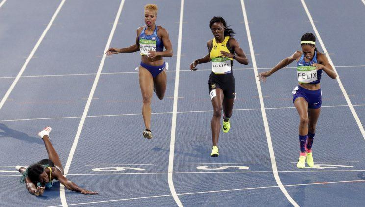Shaunae Miller defeated Allyson Felix by 0.07 seconds with a dive to the finish (AP)