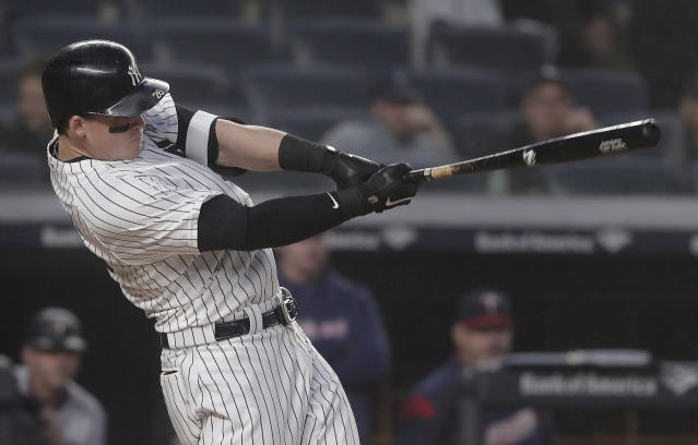 New York Yankees' Tyler Austin connects for a three-run home run against the Minnesota Twins during the third inning of a baseball game, Wednesday, April 25, 2018, in New York. (AP Photo/Julie Jacobson)