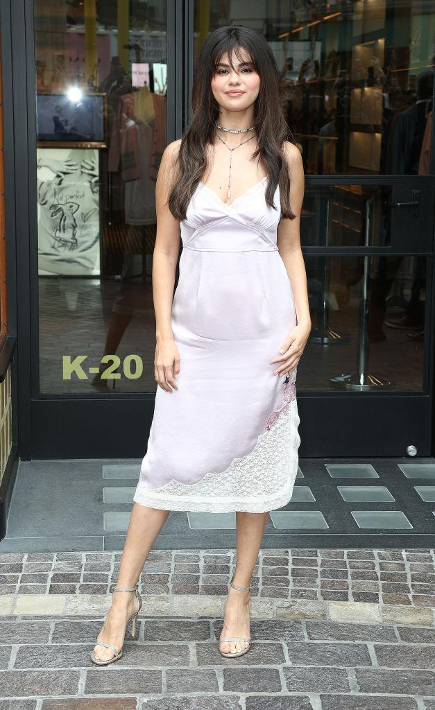 <p>On September 5, Selena Gomez hosted a meet and greet event in partnership with Coach. For the event, the singer-turned-actress opted for a lavendar-hued silk dress and silver accessories. <em>[Photo: Getty]</em> </p>
