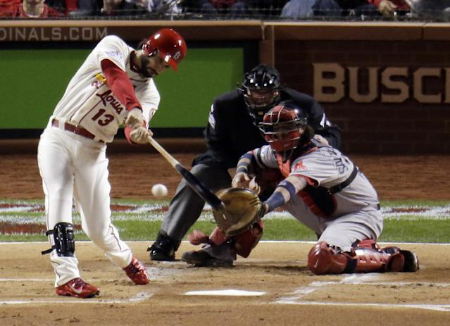 St. Louis Cardinals' Matt Carpenter hits a single during the first inning of Game 3 of baseball's World Series against the Boston Red Sox Saturday, Oct. 26, 2013, in St. Louis. (AP Photo/Charlie Riedel)