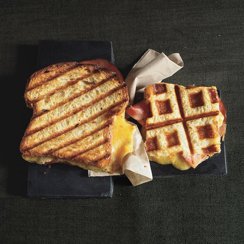 """Use a panini maker or a waffle iron to create this extra-crispy pressed sandwich. It's as cheesy as the best grilled cheese you can imagine, and hearty and balanced thanks to the turkey. Pro-move: add some <a href=""""https://www.epicurious.com/recipes/food/views/basic-cranberry-sauce-236532?mbid=synd_yahoo_rss"""" rel=""""nofollow noopener"""" target=""""_blank"""" data-ylk=""""slk:cranberry sauce"""" class=""""link rapid-noclick-resp"""">cranberry sauce</a> to give it a welcome tartness. <a href=""""https://www.epicurious.com/recipes/food/views/pressed-turkey-and-farmhouse-cheddar-on-egg-bread-239167?mbid=synd_yahoo_rss"""" rel=""""nofollow noopener"""" target=""""_blank"""" data-ylk=""""slk:See recipe."""" class=""""link rapid-noclick-resp"""">See recipe.</a>"""