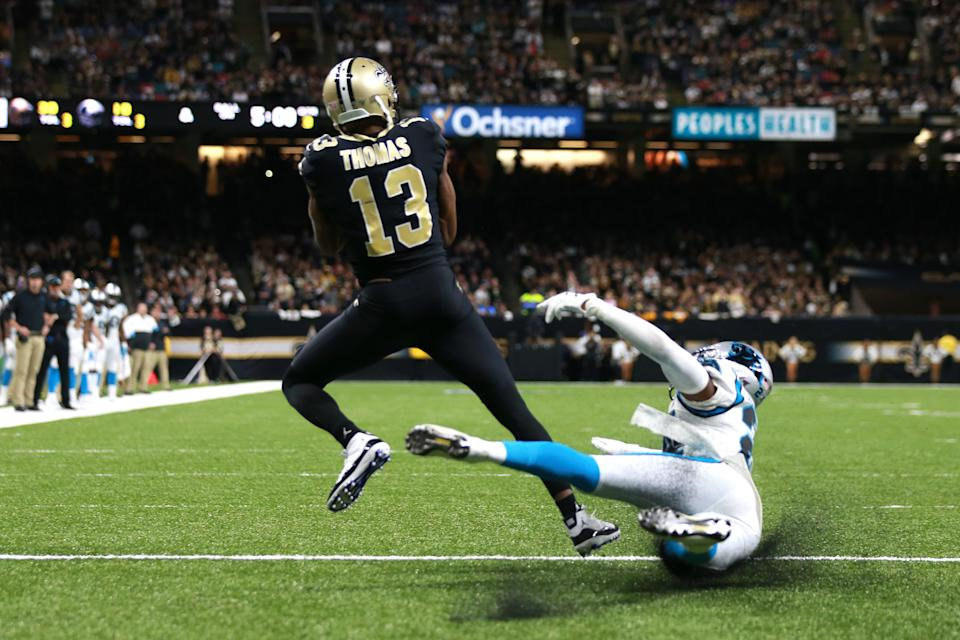 NEW ORLEANS, LOUISIANA - NOVEMBER 24: Michael Thomas #13 of the New Orleans Saints catches a 3 yard touchdown pass from Drew Brees #9 against the Carolina Panthers during the third quarter in the game at Mercedes Benz Superdome on November 24, 2019 in New Orleans, Louisiana. (Photo by Sean Gardner/Getty Images)