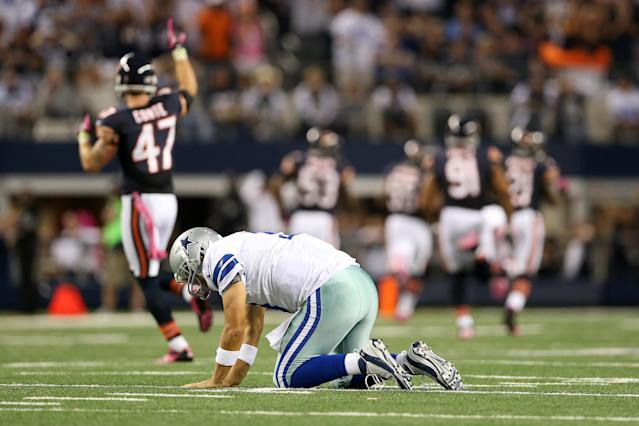 ARLINGTON, TX - OCTOBER 01: Quarterback Tony Romo #9 of the Dallas Cowboys picks himself up off the turf as Lance Briggs #55 of the Chicago Bears returns an interception of a ROmo pass 74-yards for a touchdown in the third quarter at Cowboys Stadium on October 1, 2012 in Arlington, Texas. (Photo by Ronald Martinez/Getty Images)