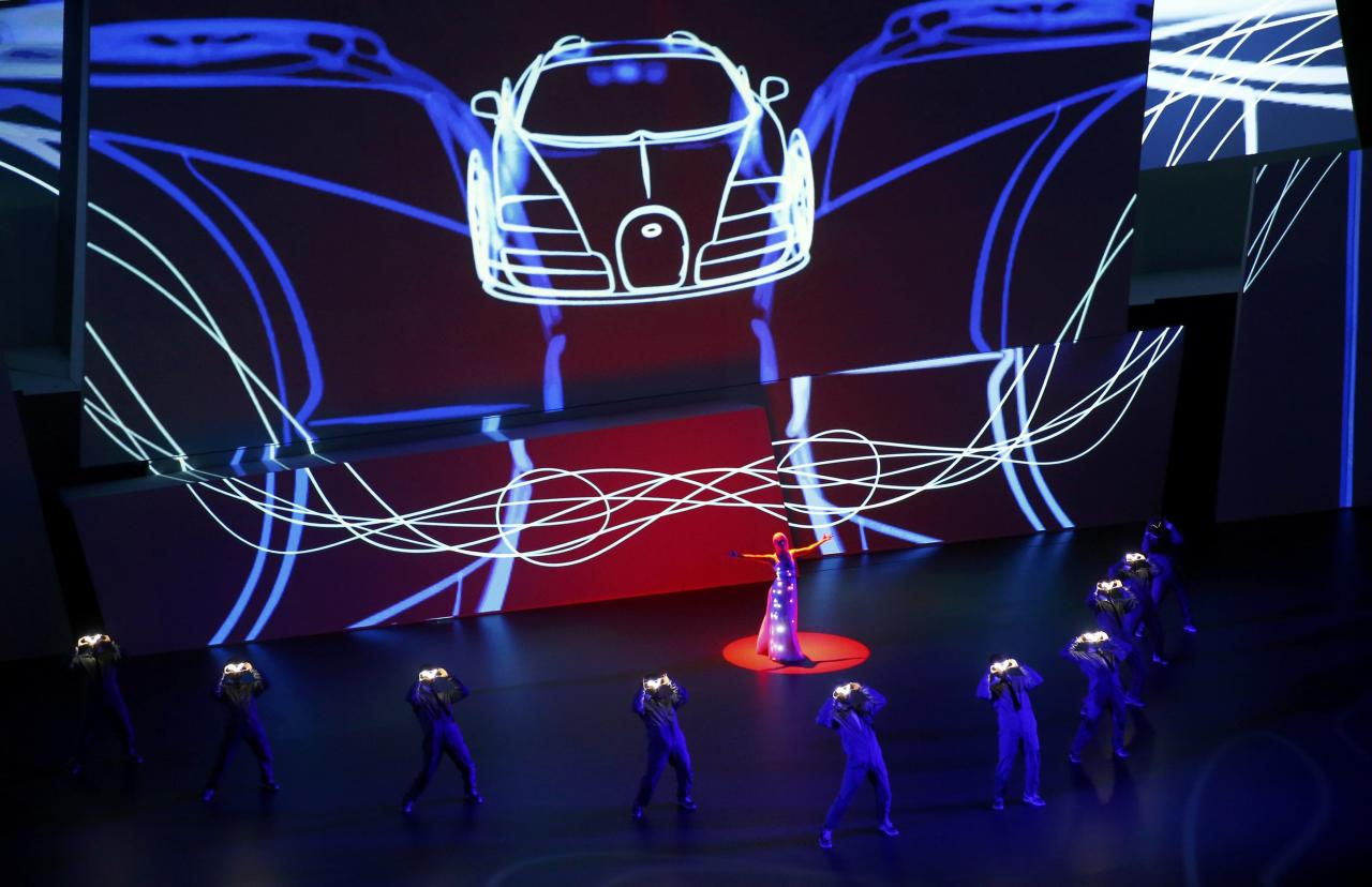 Actors performs during the Bugatti presentation at the Volkswagen group night at the Frankfurt motor show September 9, 2013. The world's biggest auto show is open to the public September 14 -22. REUTERS/Kai Pfaffenbach (GERMANY - Tags: BUSINESS TRANSPORT)