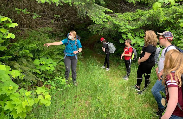 Campers and a counselor in a face mask go on a socially-distanced nature hike at Camp Wilani in Veneta, Oregon. (Camp Wilani)