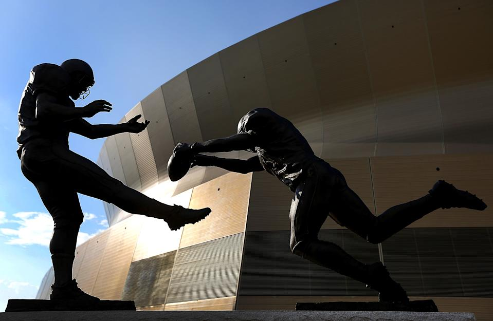 """Steve Gleason's punt block against the Falcons was immortalized in a statue titled """"Rebirth."""" (Photo by Jonathan Bachman/Getty Images)"""