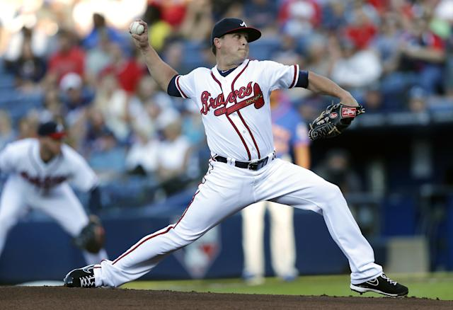 Atlanta Braves starter Kris Medlen works in the first inning of a baseball game against the New York Mets, Wednesday, June 19, 2013, in Atlanta. (AP Photo/John Bazemore)
