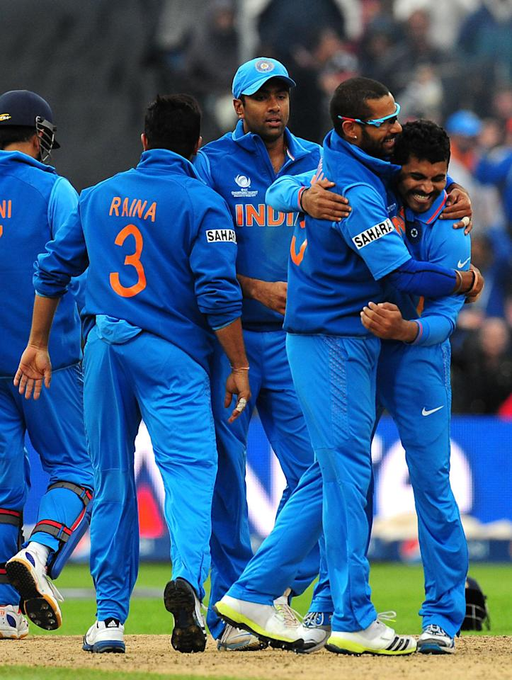 India's Ravindra Jadeja celebrates with Shikhar Dhawan after taking the wicket of Ian Bell during the ICC Champions Trophy Final at Edgbaston, Birmingham.