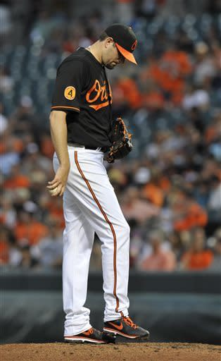 Baltimore Orioles pitcher Jason Hammel reacts after giving up four runs to the Tampa Bay Rays in the third inning of a baseball game Friday, May 17, 2013, in Baltimore. (AP Photo/Gail Burton)