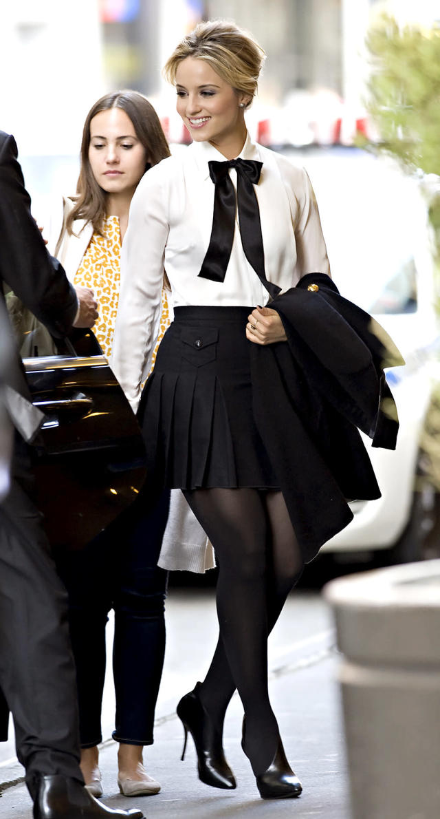 """<p><em>Glee</em> grad Agron classed up her schoolgirl look with a bow and a crisp white shirt. She added a pleated short skirt and some stilettos to earn an """"A"""" for style. (Photo: Jason Webber/Splash News) </p>"""