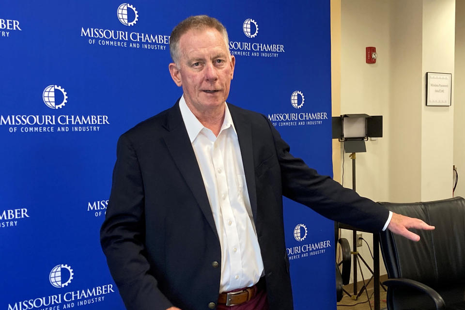 Dan Mehan, president and CEO of the Missouri Chamber of Commerce and Industry, stands against a backdrop that the chamber has used for virtual meetings during the coronavirus pandemic at its office in Jefferson City, Missouri, on May 24, 2021. The chamber supported Gov. Mike Parson's decision to use $300 million of federal coronavirus relief funds to shore up the state's unemployment insurance trust fund. (AP Photo/David A. Lieb)