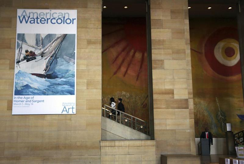 "In this Tuesday Feb. 21, 2017 photo, a banner advertises an upcoming exhibition at the Philadelphia Museum of Art in Philadelphia. ""American Watercolor in the Age of Homer and Sargent"" will be on view from March 1 to May 14, 2017, bringing together masterpieces drawn from public and private collections throughout the county, and will be shown only in Philadelphia. (AP Photo/Jacqueline Larma)"