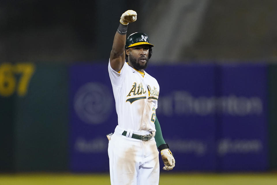 Oakland Athletics' Starling Marte gestures after hitting a two-run double against the Houston Astros during the seventh inning of a baseball game in Oakland, Calif., Friday, Sept. 24, 2021. (AP Photo/Jeff Chiu)