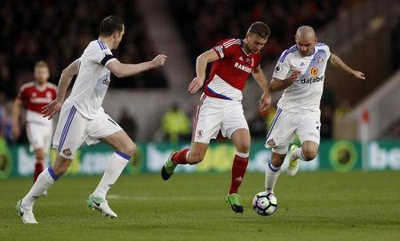 Britain Soccer Football - Middlesbrough v Sunderland - Premier League - The Riverside Stadium - 26/4/17 Middlesbrough's Ben Gibson in action with Sunderland's Wahbi Khazri Action Images via Reuters / Lee Smith Livepic
