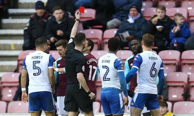 West Ham United's Arthur Masuaku receives a red card during their FA Cup Fourth Round match defeat to Wigan.