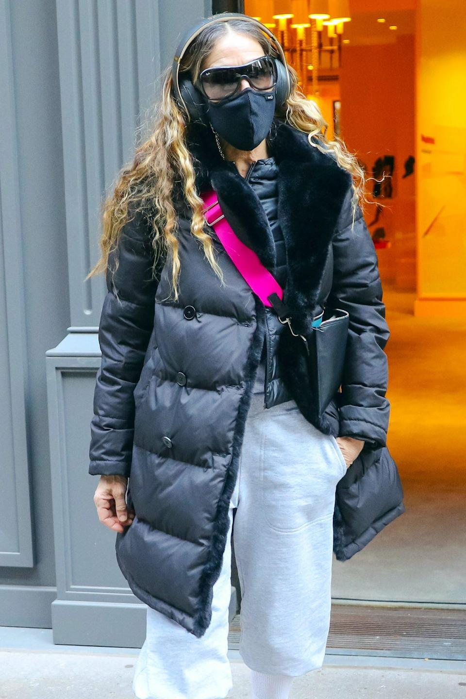 <p>Sarah Jessica Parker puts on layers to beat the N.Y.C. cold on Tuesday, as she leaves her SJP by Sarah Jessica Parker shoe store.</p>
