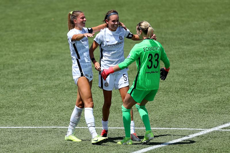 Thorns goalkeeper Britt Eckerstrom (33) celebrates with teammates Emily Menges and Kelli Hubly after upsetting the North Carolina Courage in the NWSL Challenge Cup. (Photo by Maddie Meyer/Getty Images)