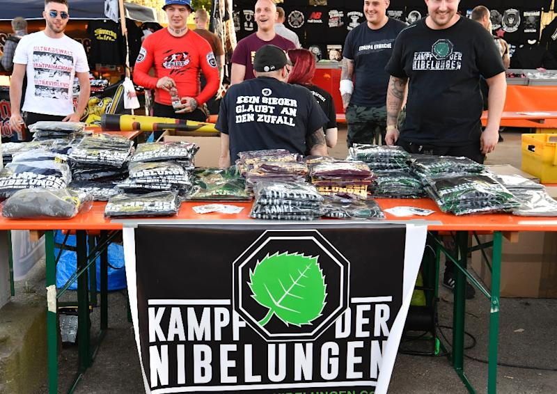 """Far-right paraphernalia is on sale at the """"Schild und Schwert"""" (Shield and Sword) neo-nazi festival, in the eastern German town of Ostritz. Hundreds of neo-Nazis were congregating on April 20, 2018, which marks Adolf Hitler's birthday (AFP Photo/John MACDOUGALL)"""